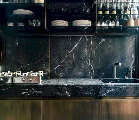 A Moody And Chic Masculine Kitchen With A Black Marble Backsplash And Countertops Rich Stained Wooden Furniture