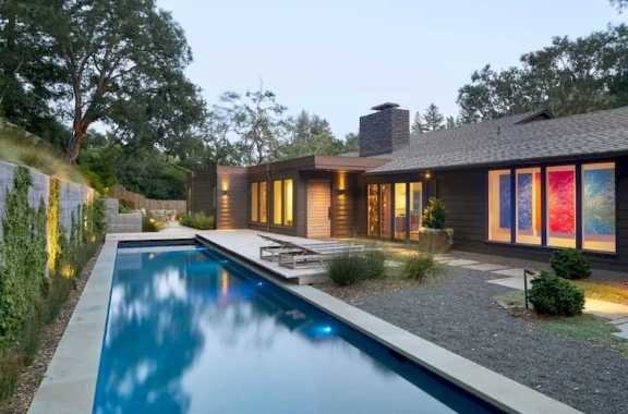 Bungalow Style Modern Home Boasts A Long Rectangular Swimming Pool