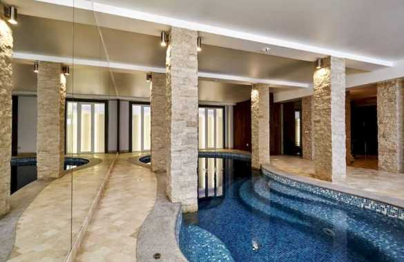 Indoor Swimming Pool With Beige Walls And Ceiling