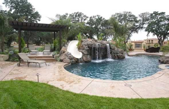 Kidney Shaped Pool Surrounded By Gardens