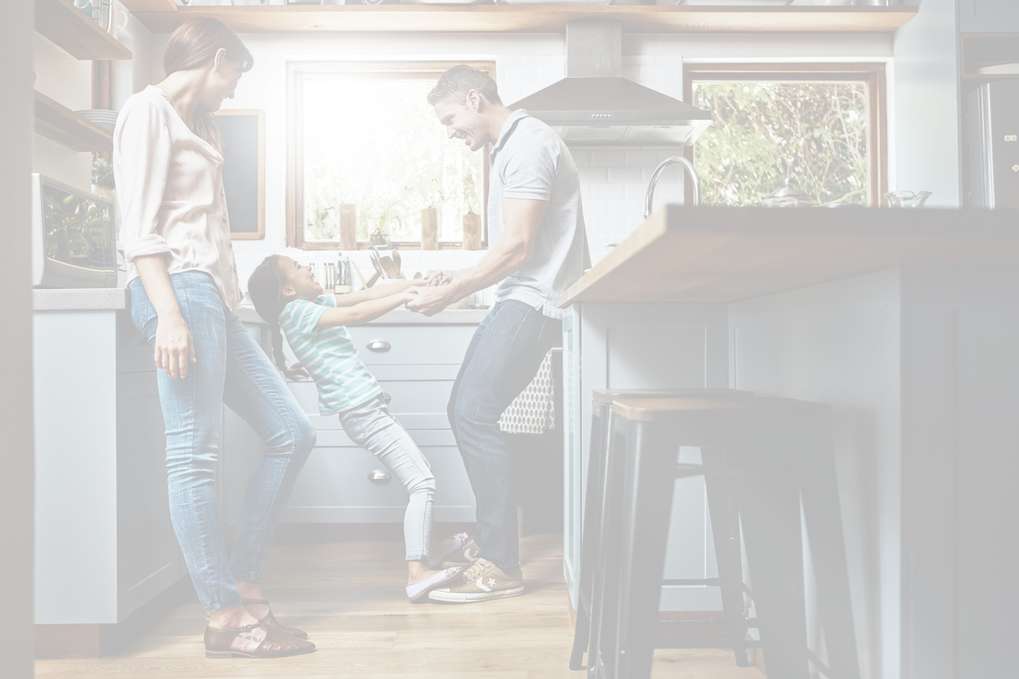 photo of family standing in kitchen talking
