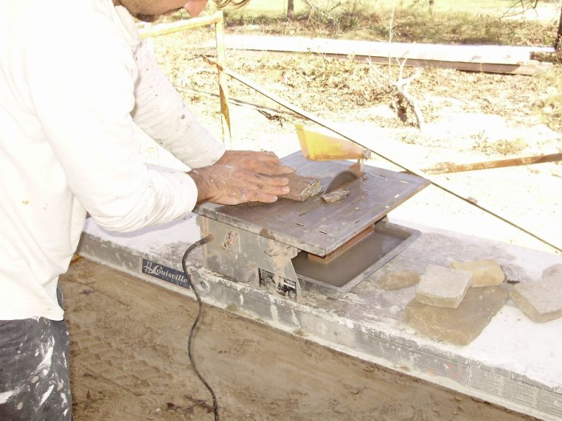 Ugly Randy cuts stone on a cheap tile wet saw