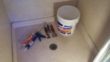 Types Of Caulk And Their Many Uses - Applying caulk to shower