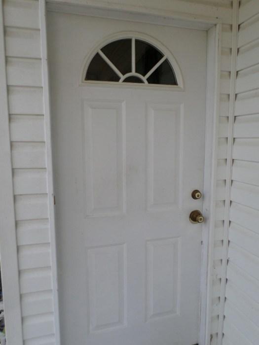This Dirty Steel Door Needs Some New Paint