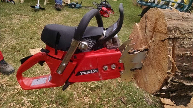 Makitas largest gas chain saw stuck into cut in log