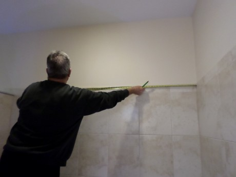Measuring over from nail to wall to transfer below