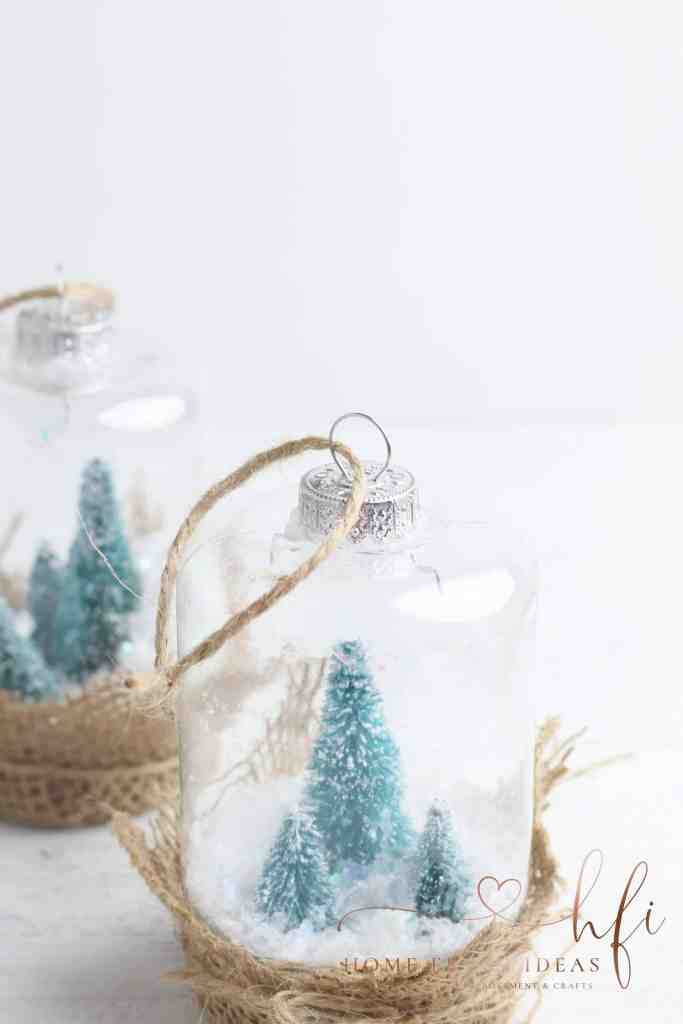 two diy snow globes on table