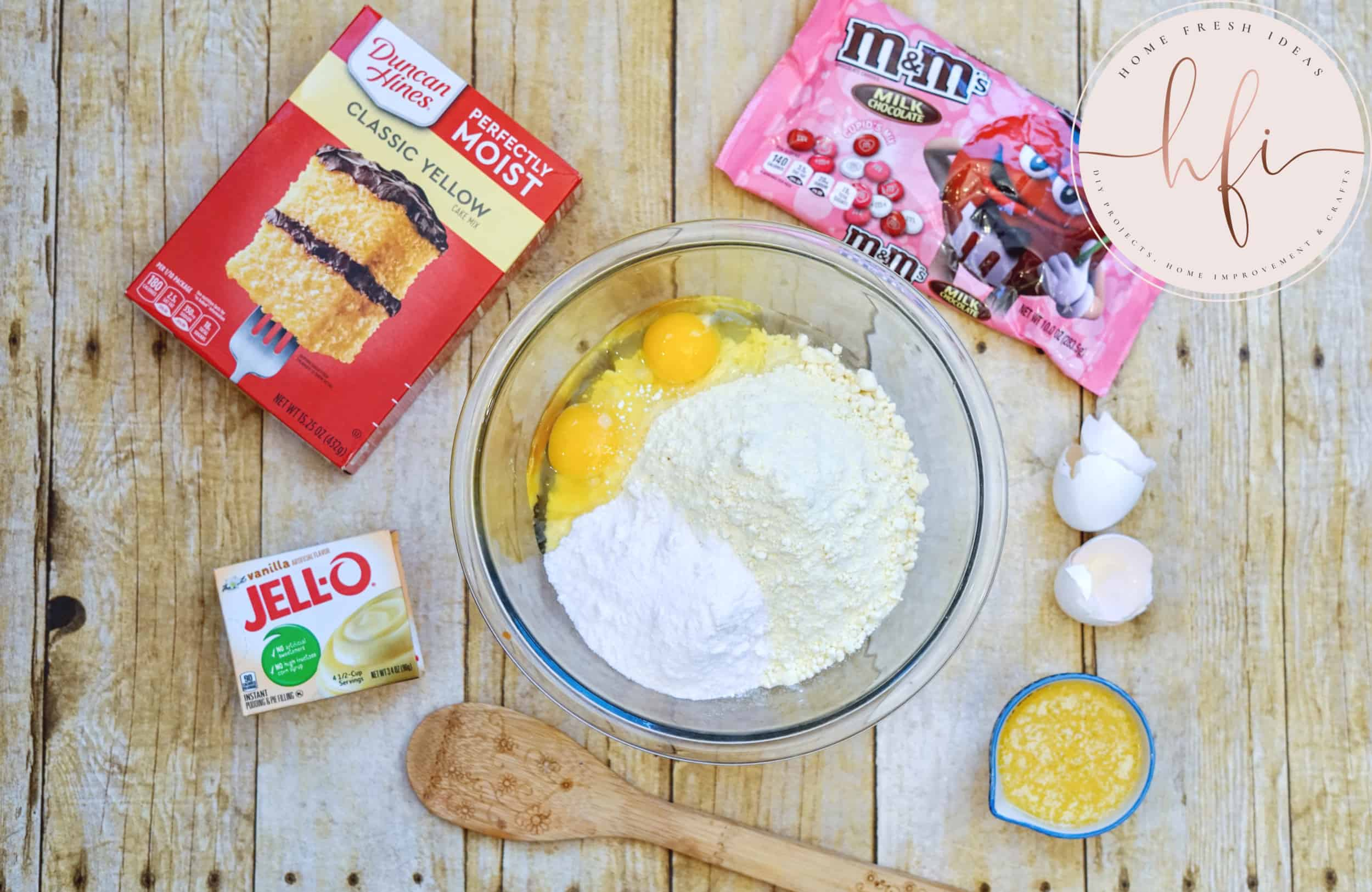 ingredients for cake mix cookie bars in bowl