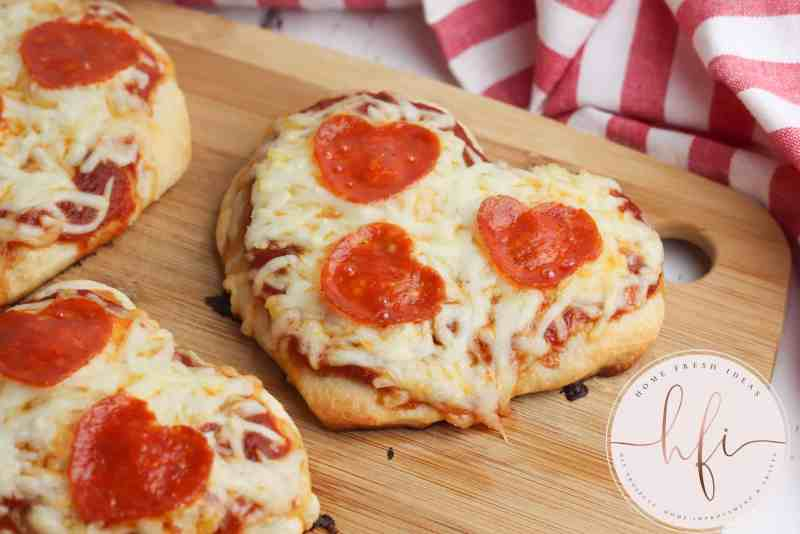 baked heart shaped pizza ready to eat