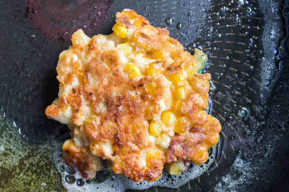 Mouthwatering Easy Corn Fritters Recipe - You are going to want to sink your teeth into this Easy Corn Fritters Recipe! They are truly mouthwatering and packed with cheese, bacon, and jalapenos. #corn #cornfritters #side #easy #delicious #cheesy #bacon #homefreshideas