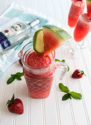 Boozy Strawberry Watermelon Drink Recipe - This delicious Watermelon Drink has a little bit of everything. Tangy limeade, strawberries, watermelon, and tequila create an irresistible drink! #watermelon #slush #drink #cocktail #margarita #homefreshideas