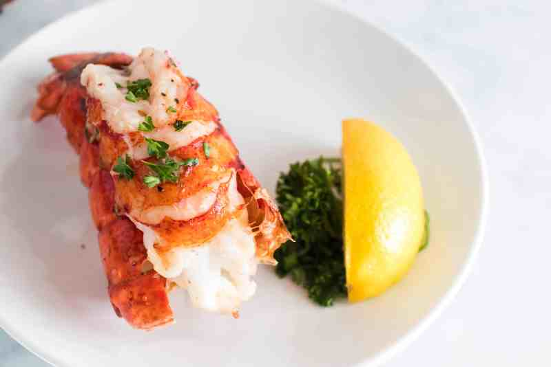 When you sink your teeth into this Juicy Air Fryer Lobster Tail you are going to be in food heaven. So succulent, buttery, and easy to make!  #lobster #lobstertail #seafood #airfryer #easy #homefreshideas