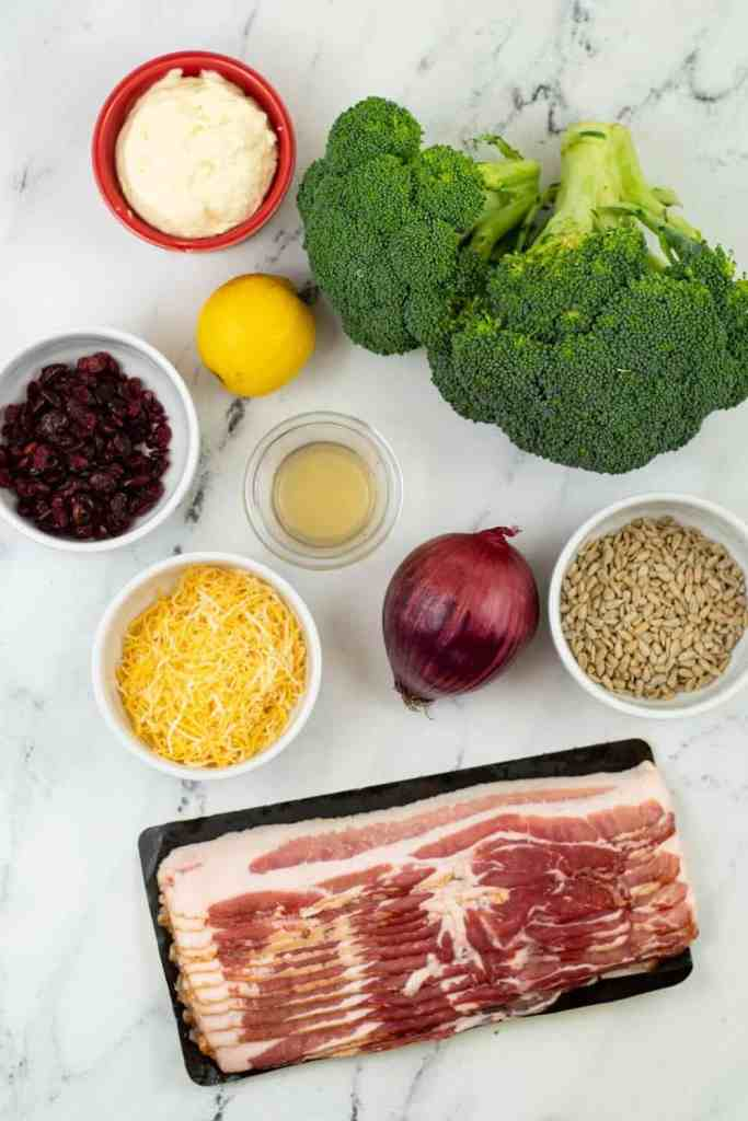 ingredients for homemade broccoli salad on marble counter