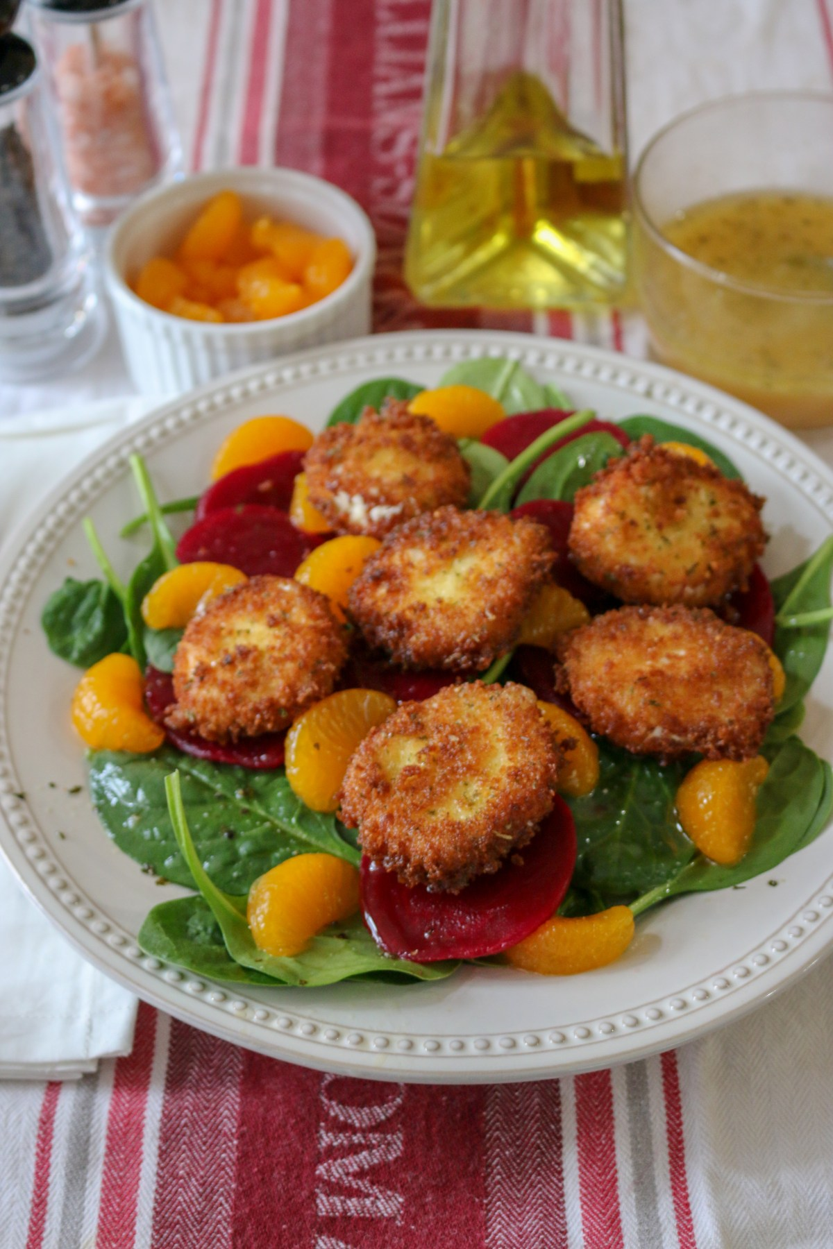 beets greens salad with crispy goat cheese and orange vinaigrette