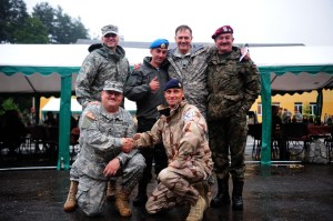 YAVORIV, Ukraine -- Master Sgt. Christopher Lopez (bottom left) and Lt. Col. Stanley Zezotarski (second from the right top) from the California National Guard pose for a photo with Ukrainian, Polish and Swedish soldiers during Exercise Rapid Trident 2013, July 13, here. (Sgt. Daniel Cole, U.S. Army Europe Public Affairs)