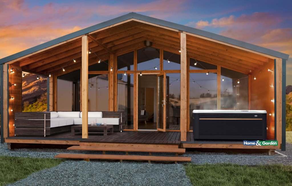 Foto van een Caldera Paradise Reunion spa op de veranda van een luxe blokhut.