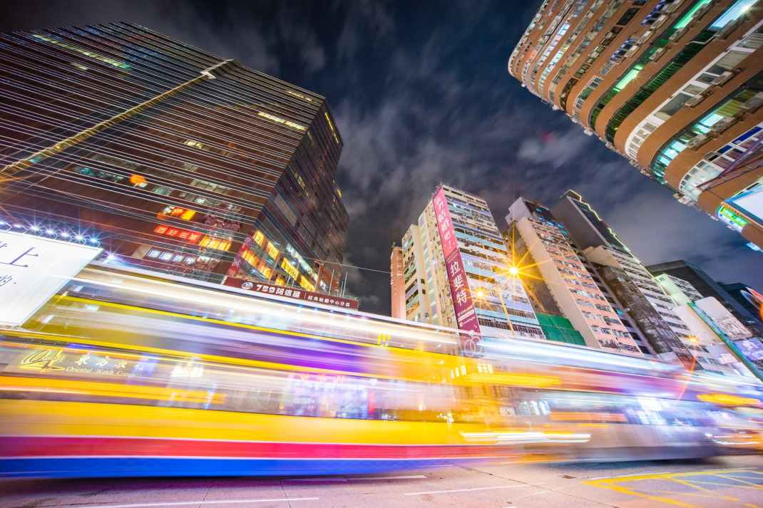time lapse photography of road near buildings