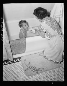 Earl Babcock's mother helping with his bath