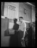 Mr. Babcock using the suggestion box at the plant to submit an idea for saving time