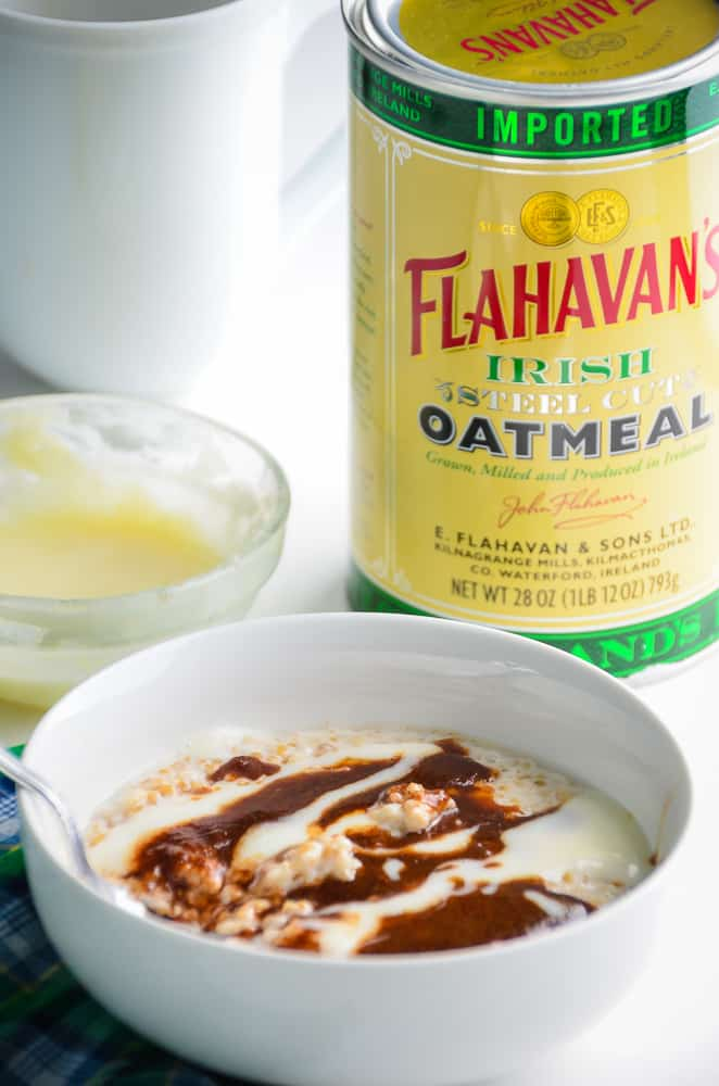 Steel Cut Oatmeal topped with cinnamon sugar and cream cheese glazes sitting next to a can of Flahavan's Irish Steel Cut Oatlmeal