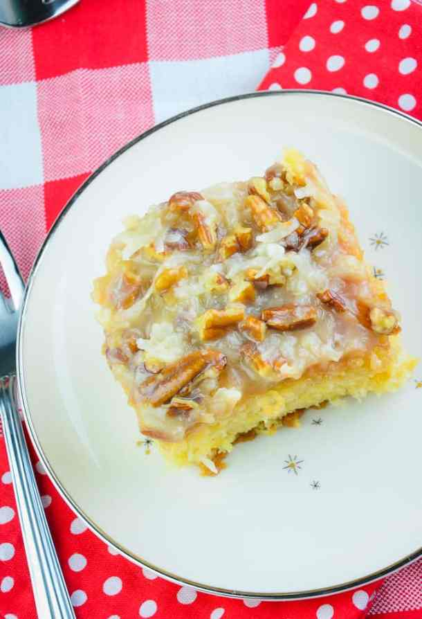Top view of Do Nothing Cake slice topping, with coconut and pecan glaze