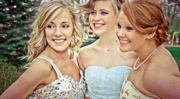 3 girls dressed for prom smiling at camera