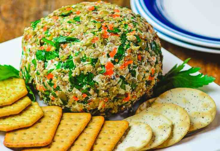 This olive cheese ball is a fun and festive appetizer for your holiday parties. Easy to make and always a crowd pleaser!