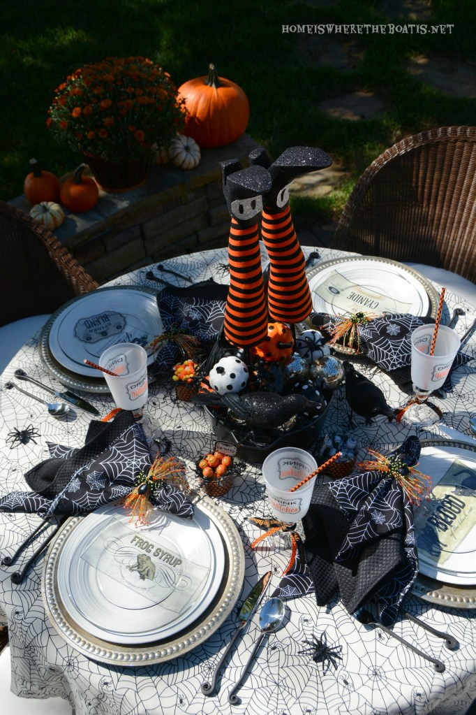 Witches' Potion Table | ©homeiswheretheboatis.net #Halloween #tablescapes #witch