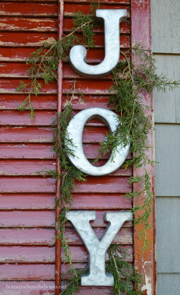 JOY on shutters of Potting Shed for Christmas | ©homeiswheretheboatis.net