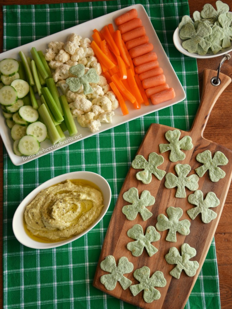 Healthy St. Patrick's Day Appetizer: Avocado-Hummus Dip with Spinach Tortilla Shamrock Chips! | ©homeiswheretheboatis.net #stpatricksday #appetizer #healthy #recipes #hummus #shamrocks