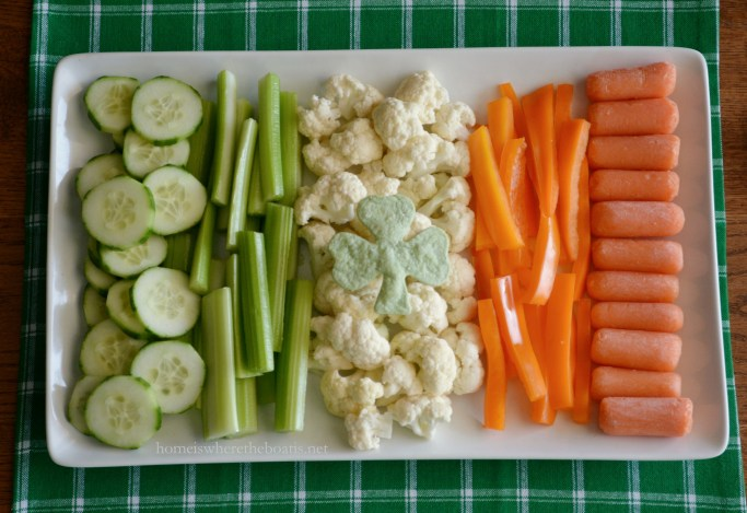 Irish Flag formation of veggies for a healthy St. Patrick's Day Appetizer with Avocado-Hummus Dip! | ©homeiswheretheboatis.net #StPatricksDay #appetizer #recipes