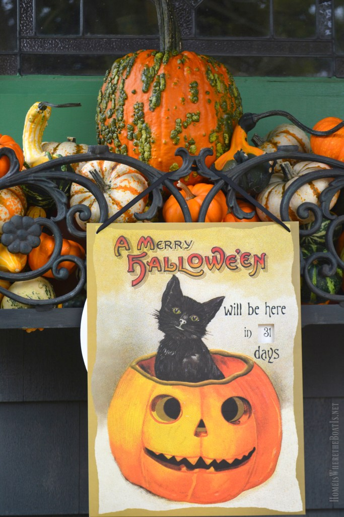 Merry Halloween countdown with pumpkin on Potting Shed porch | ©homeiswheretheboatis.net #fall #shed #pumpkins