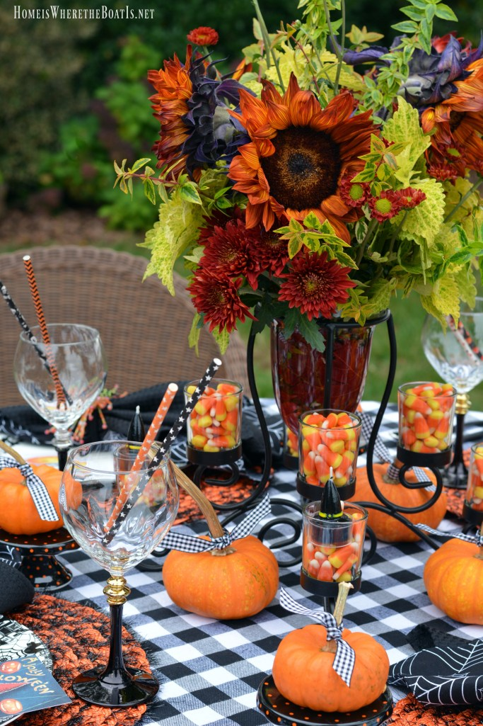 Jolly Halloween Table with sunflowers, pumpkins and candy corn | | ©homeiswheretheboatis.net #Halloween #tablescapes
