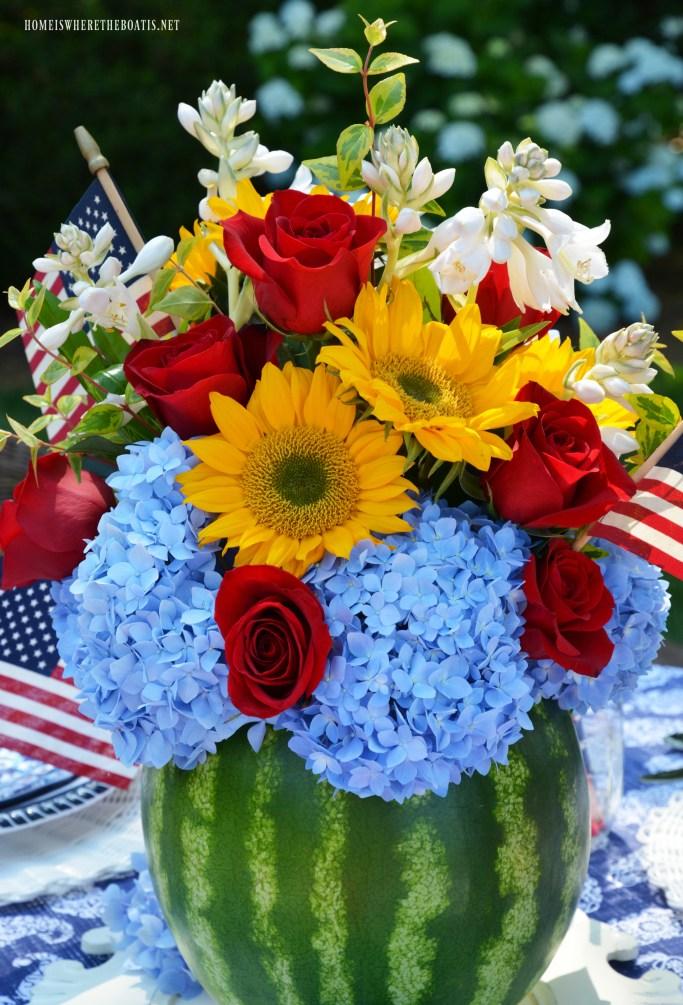 Watermelon vase party centerpiece for summer | ©homeiswheretheboatis.net #patriotic #july4th #memorialday