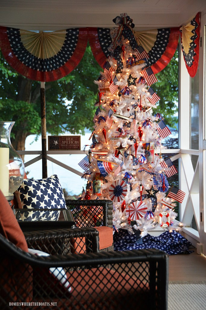 Patriotic Tree on the porch for Independence Day | ©homeiswheretheboatis.net #patriotic #tree #redwhiteandblue #porch #4thofJuly