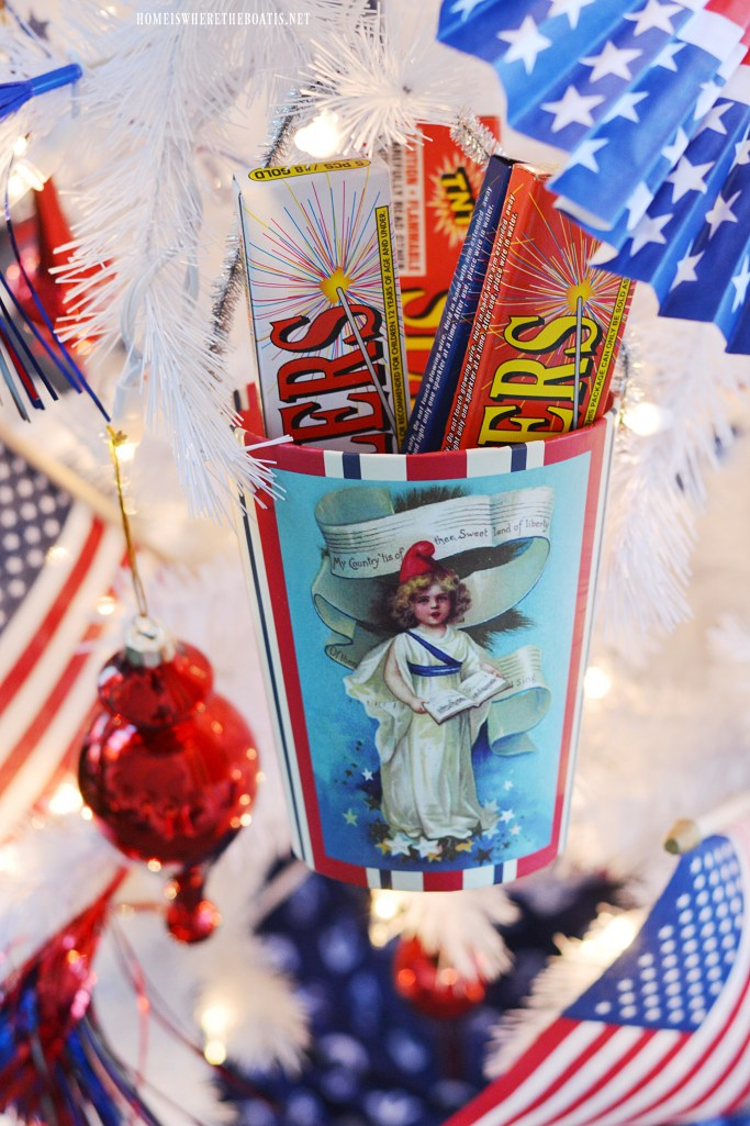 Sparklers in pail hanging from Patriotic Tree for Independence Day | ©homeiswheretheboatis.net #patriotic #tree #redwhiteandblue #porch #4thofJuly