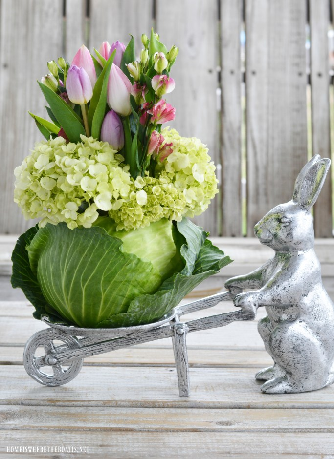 Bunny with wheelbarrow and floral cabbage arrangement DIY with tulips | ©homeiswheretheboatis.net