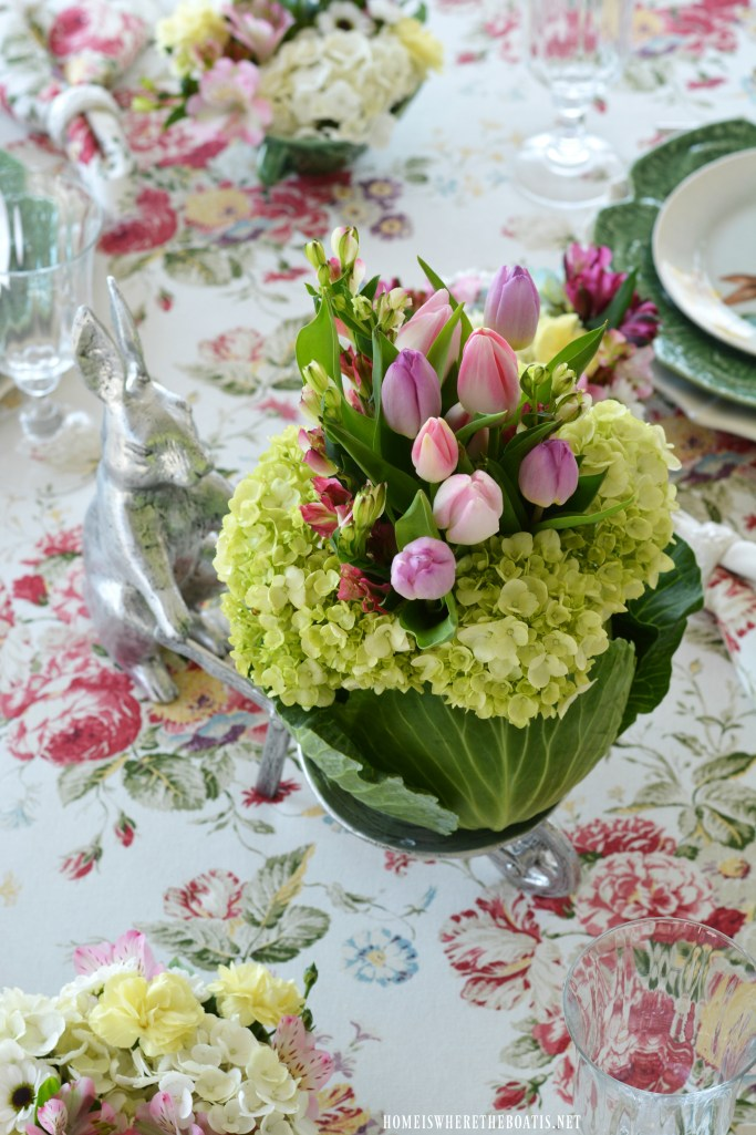 Spring table with DIY Cabbage vase flower arrangement with bunny wheelbarrow | ©homeiswheretheboatis.net #tablescapes #spring #flowers