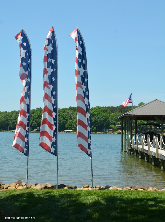 Stars and Stripes Swooper Flags on lake | ©homeiswheretheboatis.net #4thofjuly #flag #patriotic #memorialday