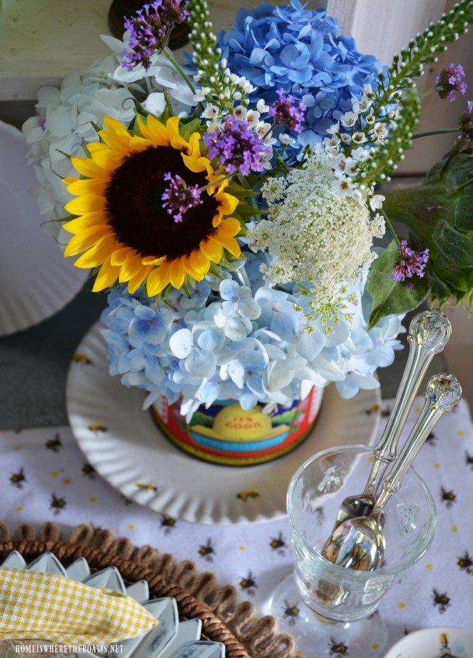 Flowers in vintage honey can for National Pollinator Week | ©homeiswheretheboatis.net #bees #tablescapes