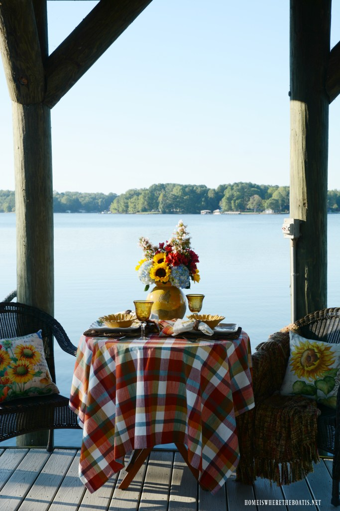 Lakeside dining with sunflowers | ©homeiswheretheboatis.net #sunflowers #lake #summer #alfresco