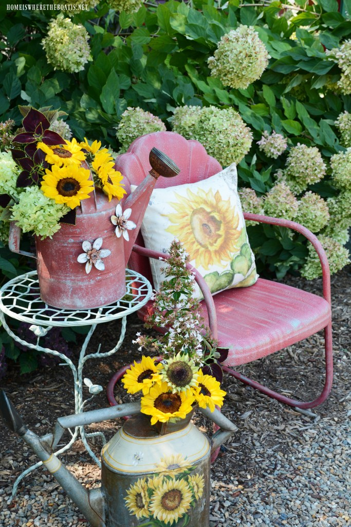 Vintage Lawn Chair with Sunflowers and Watering Cans | ©homeiswheretheboatis.net #chalkpaint #DIY #sunflowers