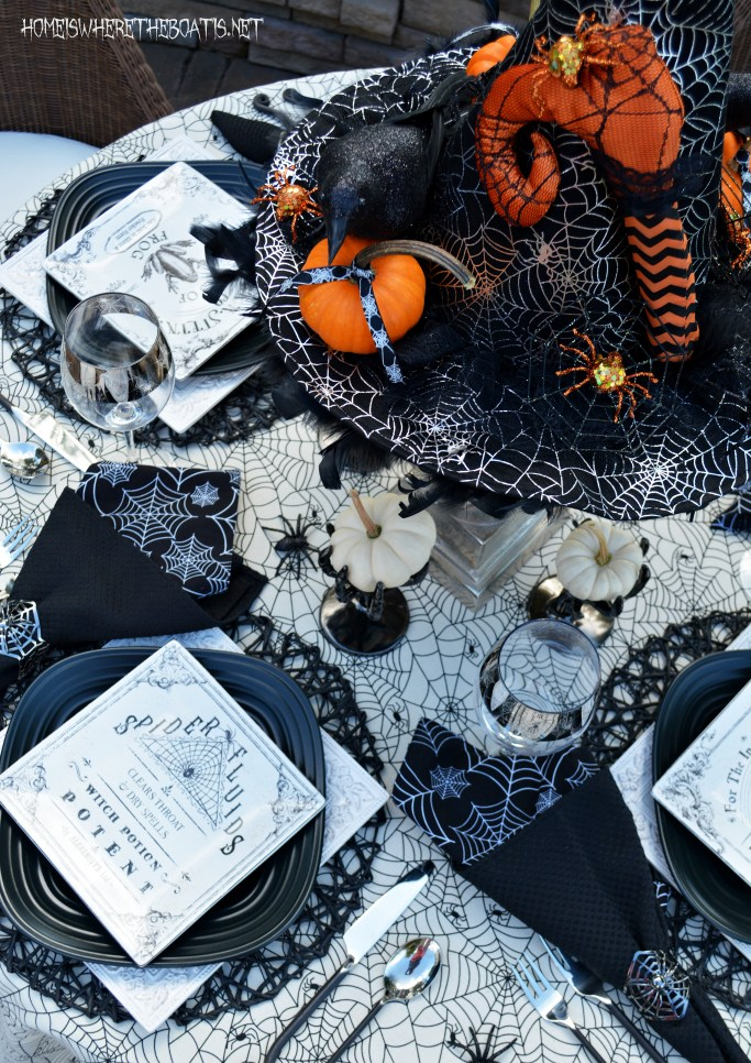 The Witching Hour Halloween Apothecary Table | | ©homeiswheretheboatis.net #Halloween #tablescapes