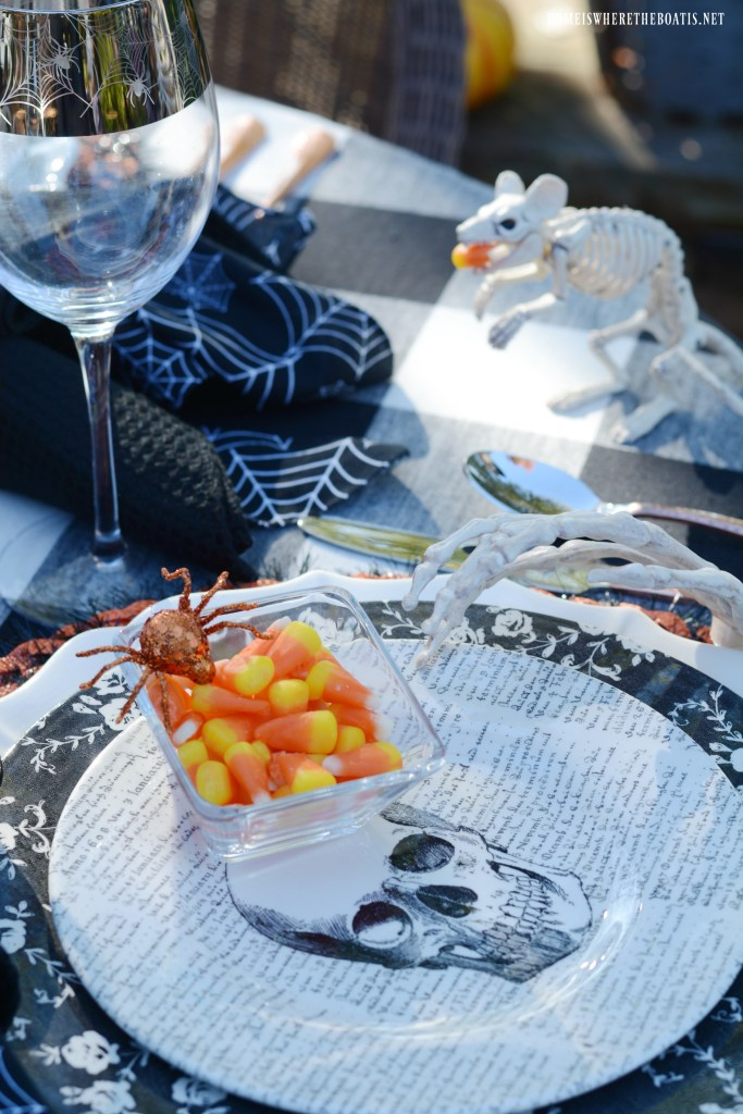 Bone Appétit table with skeletons for Halloween | ©homeiswheretheboatis.net #skeleton #halloween #tablescapes