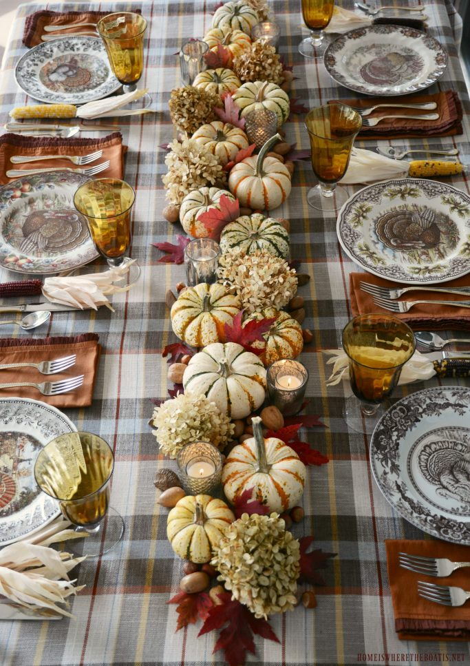 Thanksgiving table with plaid, assorted turkey plates and an easy table centerpiece | ©homeiswheretheboatis.net #thanksgiving #tablescapes #easy #turkey