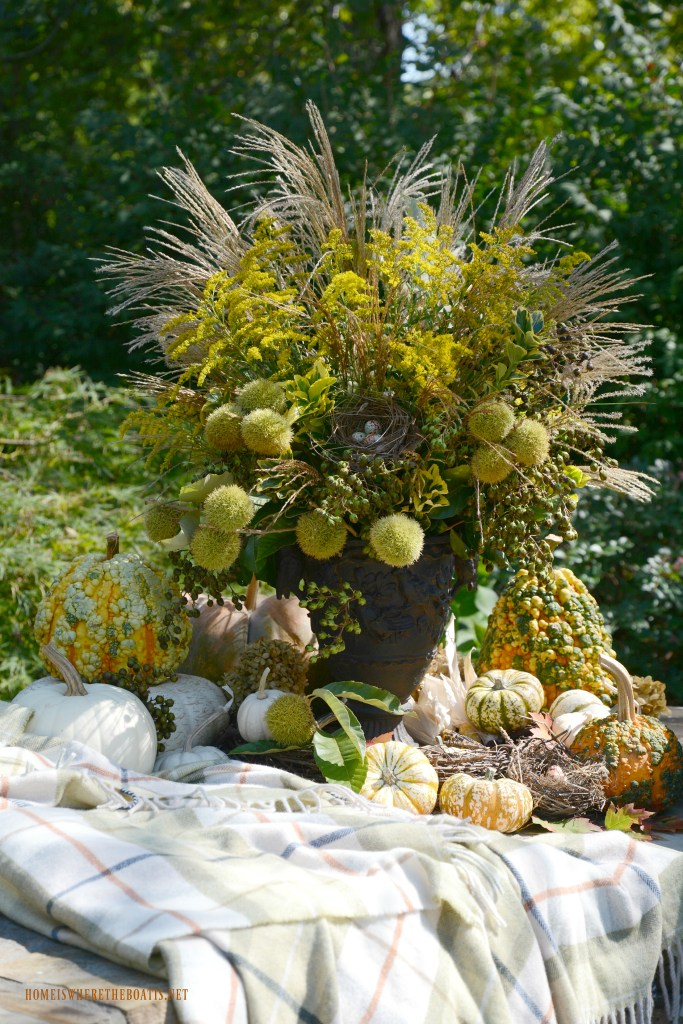 Fall vignette and arrangement with pumpkins, foliage, berries, pods and bird nest | ©homeiswheretheboatis.net #fall #arrangement
