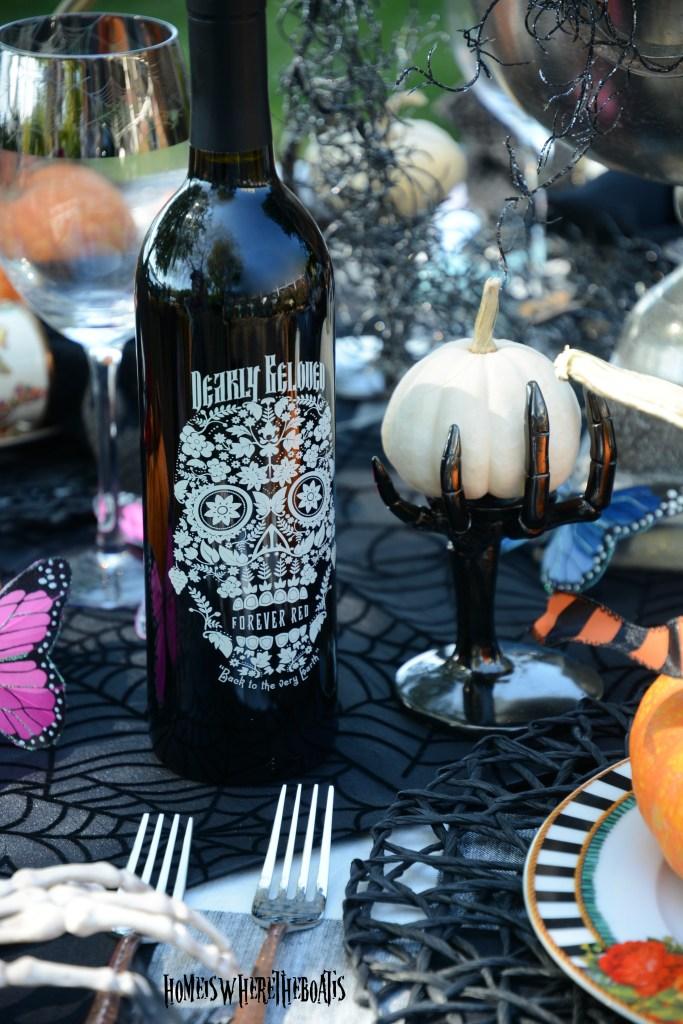 Dearly Beloved Forever Red Wine | ©homeiswheretheboatis.net #halloween #tablescapes #skeleton #garden