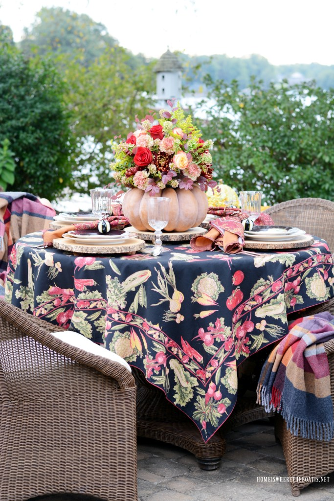Autumn table with blooming pumpkin centerpiece | ©homeiswheretheboatis.net #fall #tablescapes #centerpiece #pumpkin