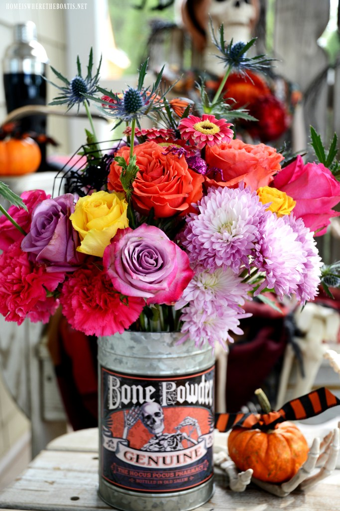 Bone Powder Flower Arrangement for Halloween | ©homeiswheretheboatis.net #Halloween #skeleton #porch #humerus