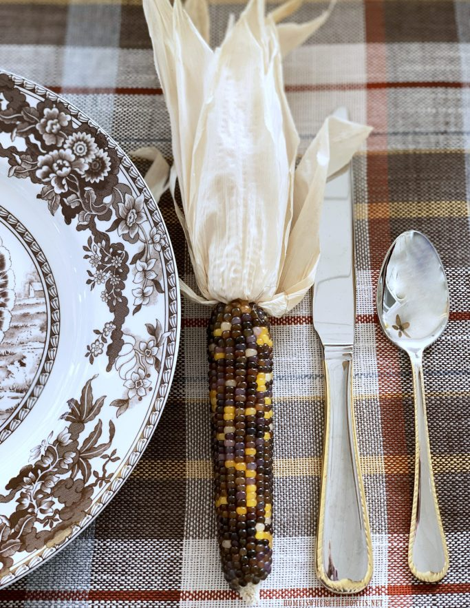 Indian corn at each placesetting for Thanksgiving | ©homeiswheretheboatis.net #thanksgiving #tablescapes #easy